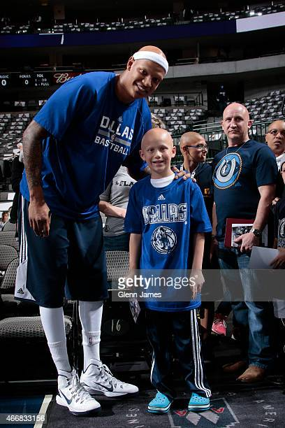 Charlie Villanueva of the Dallas Mavericks poses for photos with fans before a game against the Orlando Magic on March 18 2015 at the American...