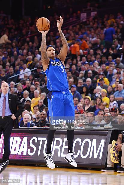 Charlie Villanueva of the Dallas Mavericks shoots against the Golden State Warriors at ORACLE Arena on February 4 2015 in Oakland California