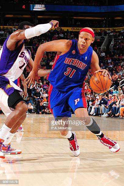 Charlie Villanueva of the Detroit Pistons makes a move to the basket against Amar'e Stoudemire of the Phoenix Suns during the game at US Airways...