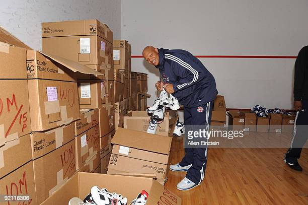 Charlie Villanueva of the Detroit Pistons selects new shoes that were distributed to1500 metro Detroit area children as part of the NBA Cares 'Week...