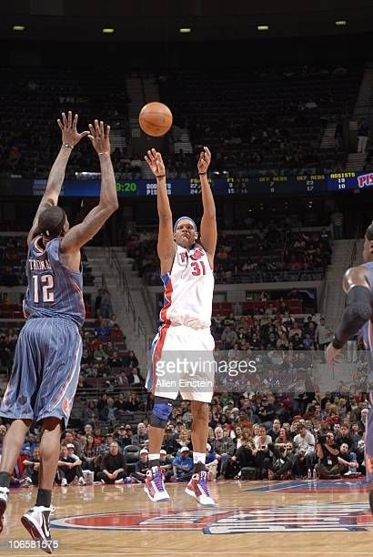 Charlie Villanueva of the Detroit Pistons shoots the basketball over Tyrus Thomas of the Charlotte Bobcats in a game on November 5 2010 at The Palace...
