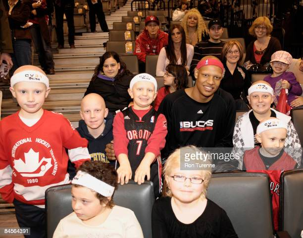 Charlie Villanueva of the Milwaukee Bucks greets and poses with fans in part of the Charlie Villaneuva Foundation prior to a game against the...