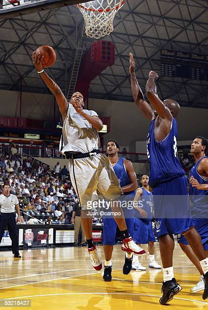 Charlie Villanueva of the Toronto Raptors drives to the hoop past Derek Hood of the Dallas Mavericks at the Southern California Summer Pro League on...