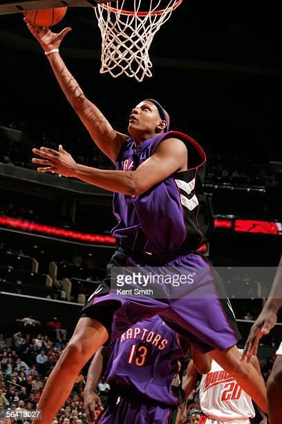 Charlie Villanueva of the Toronto Raptors shoots against the Charlotte Bobcats on December 10 2005 at the Charlotte Bobcats Arena in Charlotte North...