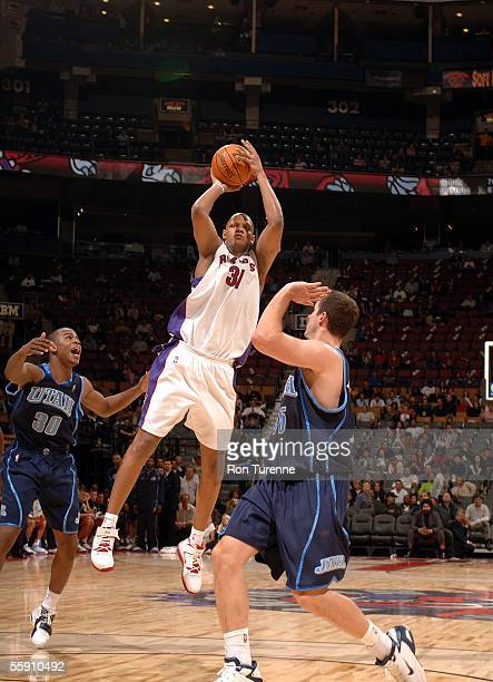 Charlie Villanueva of the Toronto Raptors takes a shot against the Utah Jazz on October 12 2005 at the Air Canada Centre in Toronto Canada The Jazz...