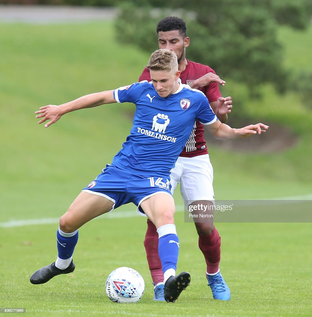 Charlie Wakefield of Chesterfield attempts to control the ball under pressure from Leon Lobjoit of Northampton Town during the Reserve Match between Northampton Town and Chesterfield at Moulton College on August 21, 2017 in Northampton, England.