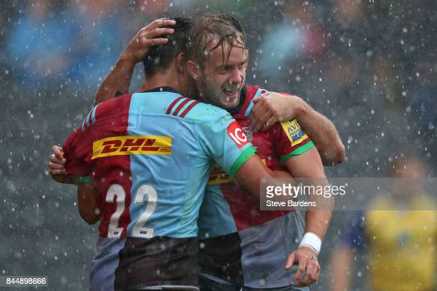 Charlie Walker of Harlequins celebrates scoring his try with Marcus Smith during the Aviva Premiership match between Harlequins and Gloucester Rugby...