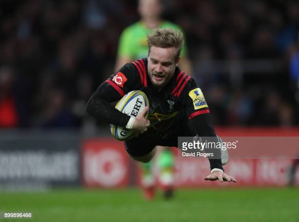 Charlie Walker of Harlequins dives to score a try during the Aviva Premiership Big Game 10 match between Harlequins and Northampton Saints at...