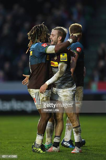 Charlie Walker of Harlequins is congratulated after scoring a try during the Aviva Premiership match between Harlequins and Sale Sharks at Twickenham...