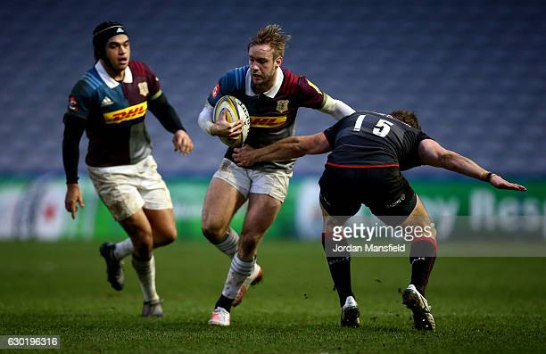 Charlie Walker of Harlequins is tackled by Andrew Fenby of Saracens Storm during the Aviva A League match between Harlequins and Saracens Storm at...