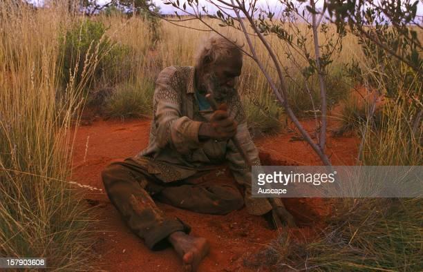 Charlie Wallabi making a bush sandal from the ngulupi bush Great Sandy Desert Western Australia