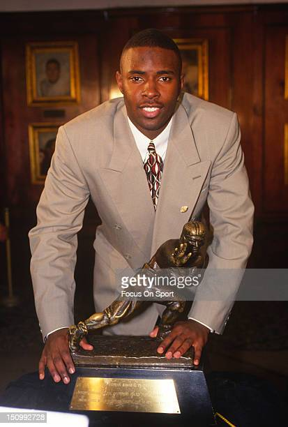 Charlie Ward of Florida State University poses with the Heisman Trophy at the Downtown Athletic Club circa 1993 in New York City New York Ward won...