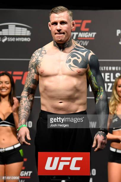 Charlie Ward of Ireland poses on the scale during the UFC Fight Night weighin at the SSE Hydro Arena Glasgow on July 15 2017 in Glasgow Scotland