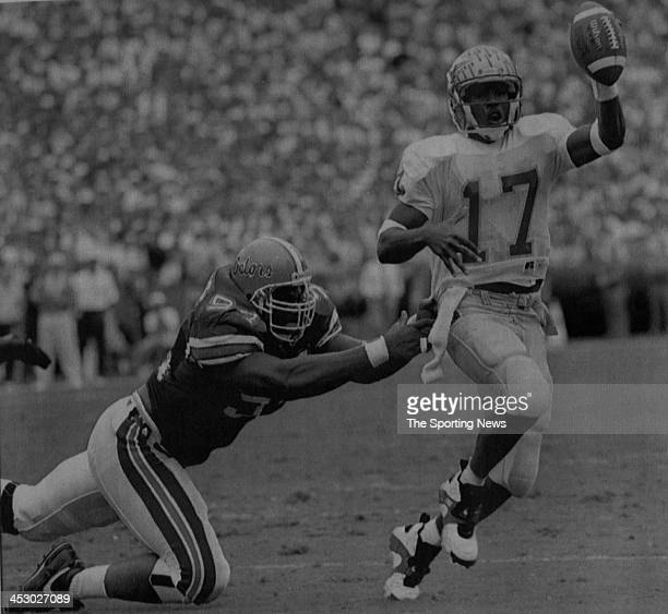 Charlie Ward of the Florida State Seminoles against William Gaines of the Florida Gators on November 27 1993 at in Gainsville Florida Ward played for...