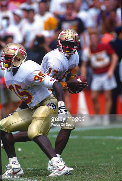 Charlie Ward of the Florida State Seminoles drops back to pass against the University of Miami during an NCAA football game at the Orange Bowl...