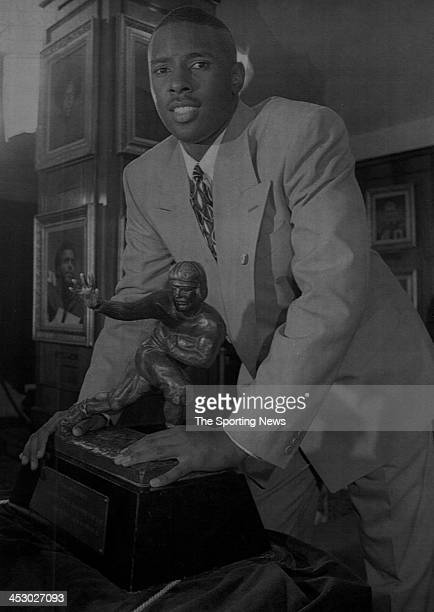 Charlie Ward of the Florida State Seminoles poses with the Heisman Trophy after he won the award on December 11 1993 at the Downtown Athletic Club in...