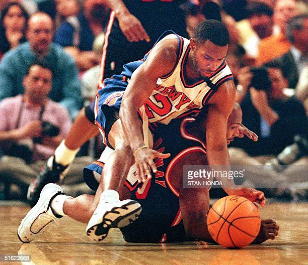 Charlie Ward of the New York Knicks dives for the ball over Tim Hardaway of the Miami Heat in the first quarter of their game 07 February at Madison...
