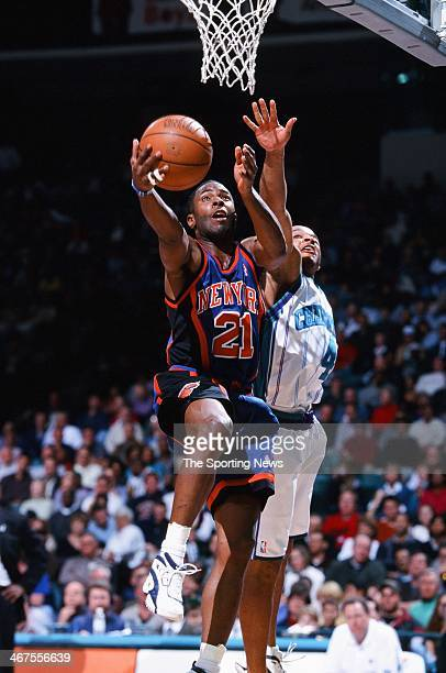 Charlie Ward of the New York Knicks lays up a shot against David Wesley of the Charlotte Hornets during the game on February 7 2000 at Charlotte...