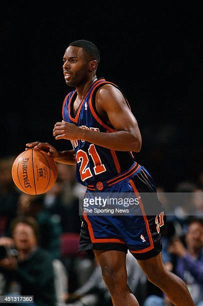Charlie Ward of the New York Knicks moves the ball during the game against the Houston Rockets on November 18 1997 at the Compaq Center in Houston...