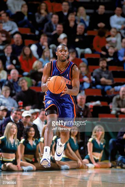 Charlie Ward of the New York Knicks sets up the play against the Seattle Sonics during the NBA game at Key Arena on December 3 2003 in Seattle...