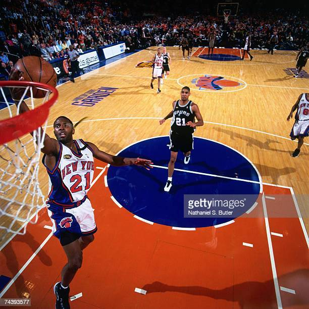 Charlie Ward of the New York Knicks shoots a layup against Tim Duncan of the San Antonio Spurs during Game Four of the 1999 NBA Finals played on June...