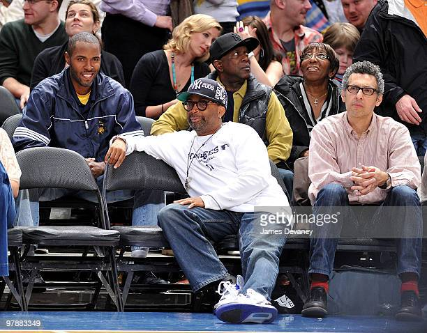 Charlie Ward Spike Lee and John Turturro attend a game between the Philadelphia 76ers and the New York Knicks at Madison Square Garden on March 19...
