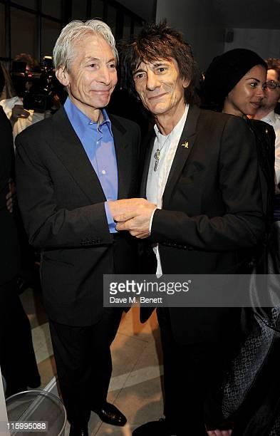 Charlie Watts and Ronnie Wood attend the launch of jockey Frankie Dettori's new restaurant 'Cavallino' on June 13 2011 in London England