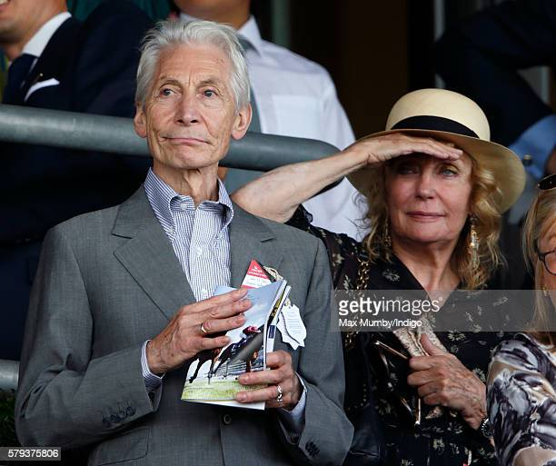 Charlie Watts and Shirley Ann Shepherd watch the racing as they attend the King George VI Weekend at Ascot Racecourse on July 23 2016 in Ascot England