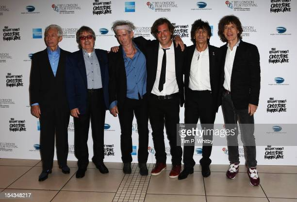 Charlie Watts Bill Wyman Keith Richards director Brett Morgen Ronnie Wood and Mick Jagger of the Rolling Stones attend the Premiere of 'Crossfire...