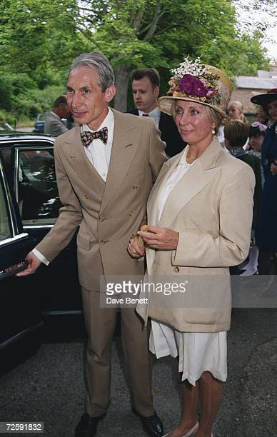 Charlie Watts , drummer of The Rolling Stones, and his wife Shirley Ann Shepherd attend Georgia May Jagger's christening at Saint Andrew's Church on...