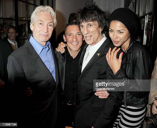 Charlie Watts Frankie Dettori Ronnie Wood and Ana Araujo attend the launch of jockey Frankie Dettori's new restaurant 'Cavallino' on June 13 2011 in...