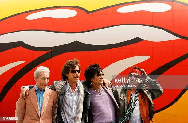 Charlie Watts Mick Jagger Ron Wood and Keith Richards of the Rolling Stones pose after arriving 07 May 2002 in front of a blimp with a Rolling Stones...