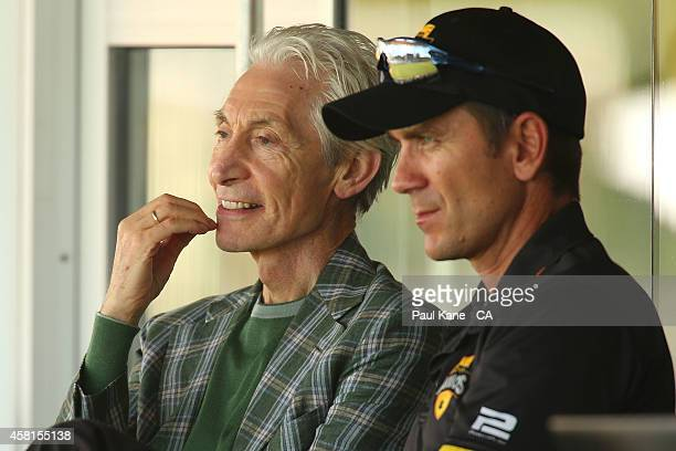 Charlie Watts of the Rolling Stones watches the action from the players pavillion with Western Australian coach Justin Langer during day one of the...