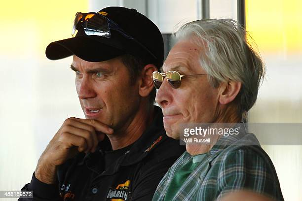 Charlie Watts of the Rolling Stones watches the action from the players pavilion with Western Australian coach Justin Langer during day one of the...