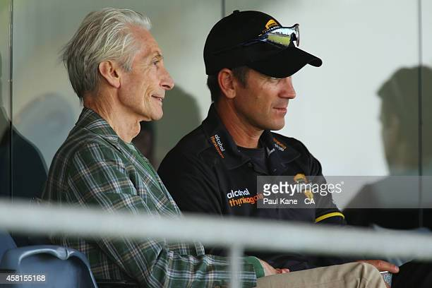 Charlie Watts of the Rolling Stones watches the action with Western Australian coach Justin Langer in the players pavillion during day one of the...