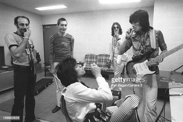 Charlie Watts Ronnie Wood and Keith Richards of The Rolling Stones are photographed backstage with friends in 1975 in San Antonio Texas CREDIT MUST...