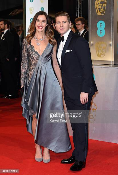 Charlie Webster and Allen Leech attend the EE British Academy Film Awards at The Royal Opera House on February 8 2015 in London England