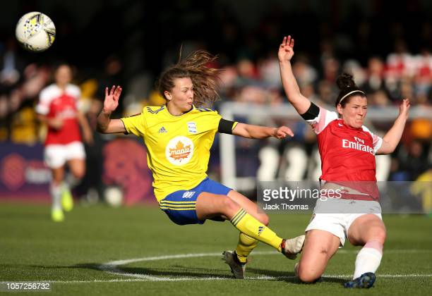 Charlie Wellings of Birmingham Ladies shoots but is blocked by Emma Mitchell of Arsenal Women during the WSL match between Arsenal Women and...
