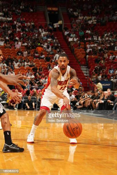 Charlie Westbrook of the Miami Heat bounce passes the ball against the San Antonio Spurs during a game on October 19 2013 at American Airlines Arena...
