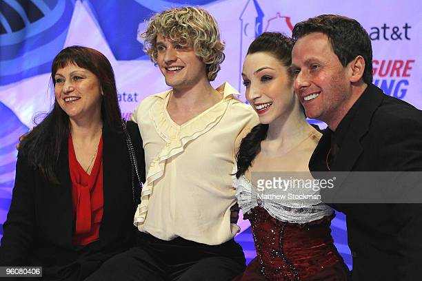 Charlie White and Meryl Davis in the kiss and cry with their coaches Marina Zoueva and Igor Shpilband after the free dance competition during the US...