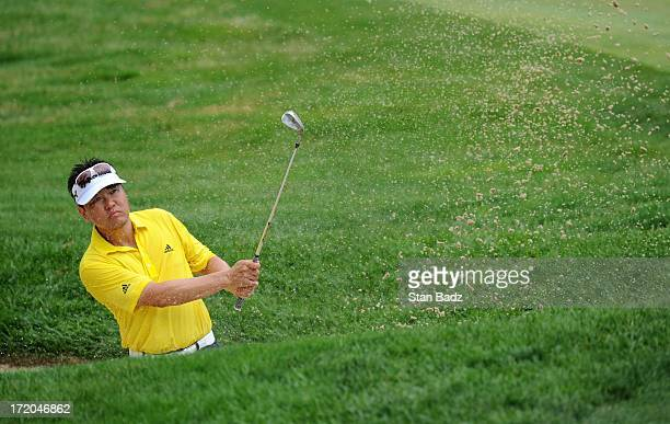 Charlie Wi hits from a bunker on the third hole during the final round of the ATT National at Congressional Country Club on June 30 2013 in Bethesda...