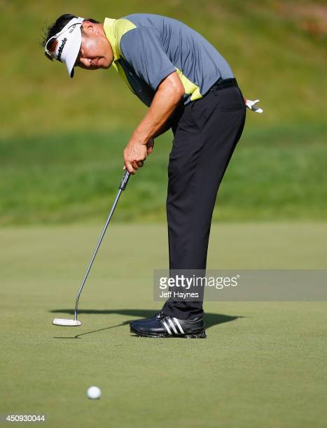 Charlie Wi of Korea putts on the 11th green during the second round of the Travelers Championship golf tournament at the TPC River Highlands on June...