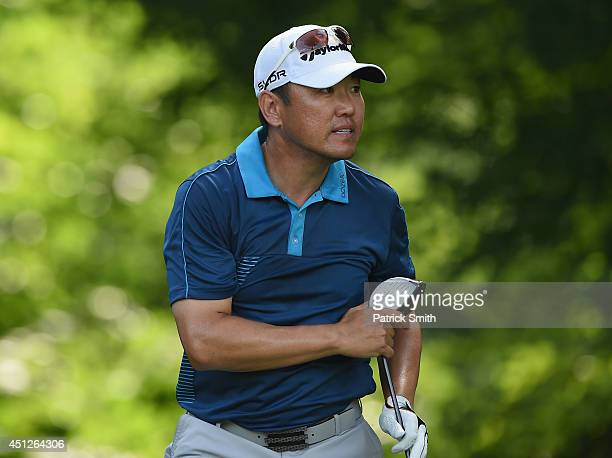 Charlie Wi of Korea watches his tee shot on the 14th hole during the first round of the Quicken Loans National at Congressional Country Club on June...