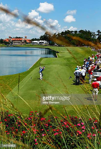 Charlie Wi of South Korea hits his tee shot on the 18th hole during the second round of THE PLAYERS Championship held at THE PLAYERS Stadium course...