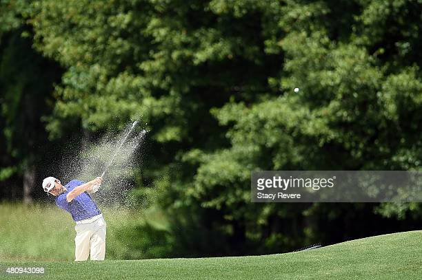 Charlie Wi of the United States hits his second shot on the fifth hole during the first round of the Barbasol Championship at the Robert Trent Jones...