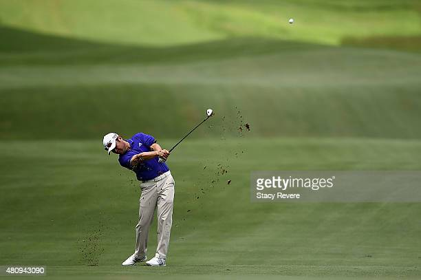 Charlie Wi of the United States hits his third shot on the fifth hole during the first round of the Barbasol Championship at the Robert Trent Jones...
