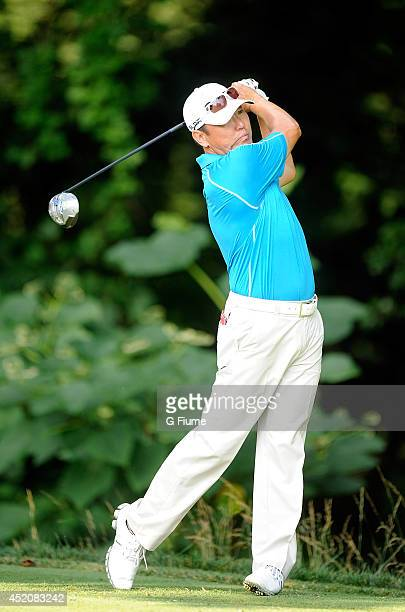 Charlie Wi tees off on the 14th hole during the second round of the Quicken Loans National at Congressional Country Club on June 27 2014 in Bethesda...