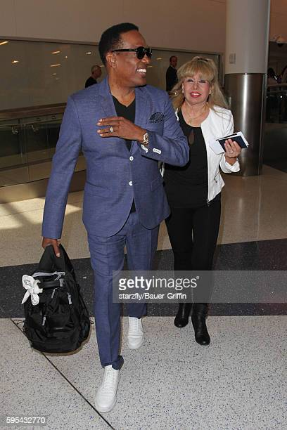 Charlie Wilson and Mahin Wilson are seen at LAX on August 25 2016 in Los Angeles California