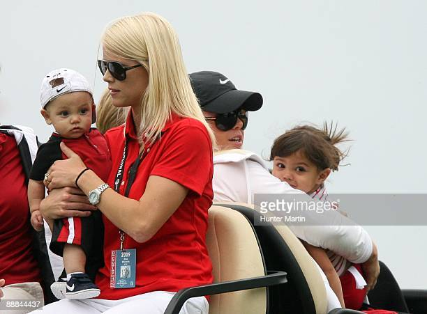 Charlie Woods Elin Woods Josefin Nordegren and Sam Woods ride in a golf cart after the final round of the ATT National hosted by Tiger Woods at...