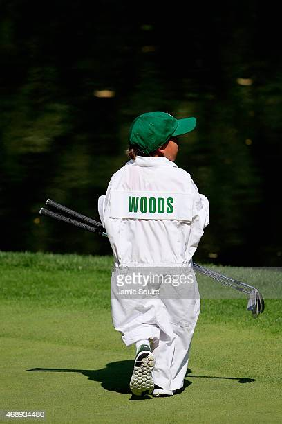 Charlie Woods walks across a green during the Par 3 Contest prior to the start of the 2015 Masters Tournament at Augusta National Golf Club on April...